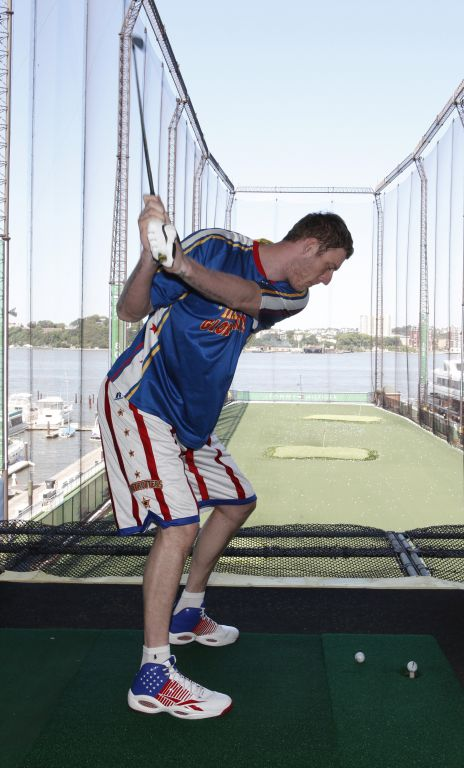 Tiny Sturgess golfing at Chelsea Piers1.jpg