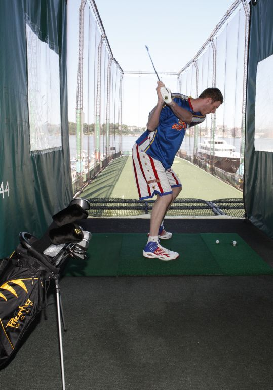 Tiny Sturgess golfing at Chelsea Piers2.jpg